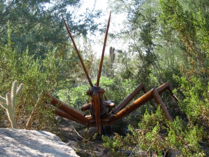 The giant wheel bug stalks you through the vegetation.