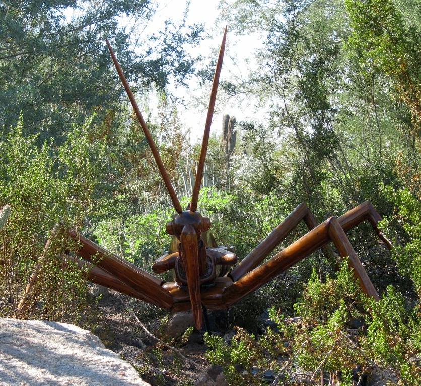 The giant wheel bug stalks you through the vegetation.