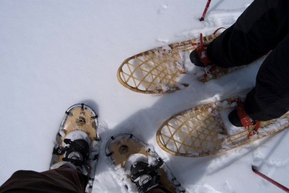 My feet on the left in modern-style snowshoes, Leanna's on the right in traditional snowshoes she wove and lacquered herself.